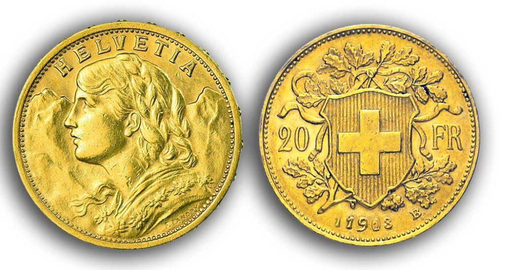 cara y cruz de la moneda de 20 francos suizos vreneli 1913, una moneda de oro de 5,80 gramos.