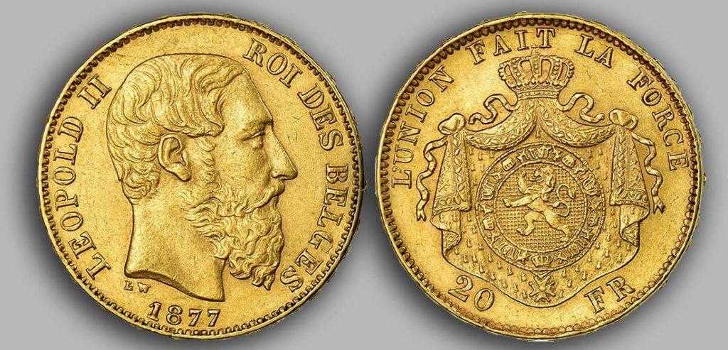 Avers y Revers de la 20 Francs belge Napoléon Or 1877. Le Louis Belge de 20 Francs or 1877 est une Pièce d'Or belge de 5,80 gramme d'or fin d'un diamètre de 21,40 mm. 5 906 070 exemplaires furent frappés à Bruxelles.