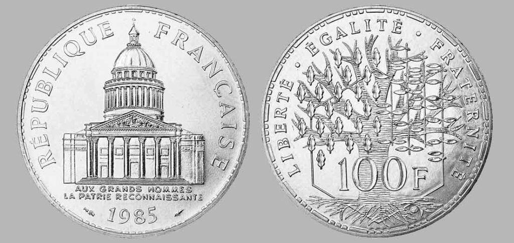 La pièce de monnaie françaises de 100 francs en argent 1985 pèse 15 grammes et possèdent 90% d'argent pur. Tirage : 987 200 exemplaires cette année, 15 millions d'exemplaires en total.